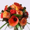 Bride's handtied bouquet in hints of burnt orange and chocolate, using calla lilies and roses