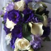 Rich Bride's shower bouquet in cadbury's purple, lilac and ivory